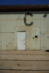 2017-11-04 1423 C Shed sign above door, railway tracks in front.JPG